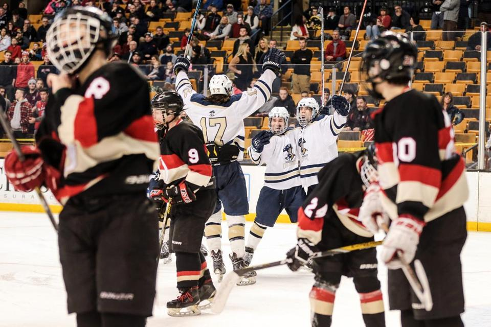03/19/2017 BOSTON, MA Shrewsbury players celebrated their second goal scored by Tyler Borys (cq) 7, during the Division 3 finals between the Shrewsbury Colonials and the Old Rochester Bulldogs the MIAA High School Hockey Tournament held at TD Garden in Boston. (Aram Boghosian for The Boston Globe)