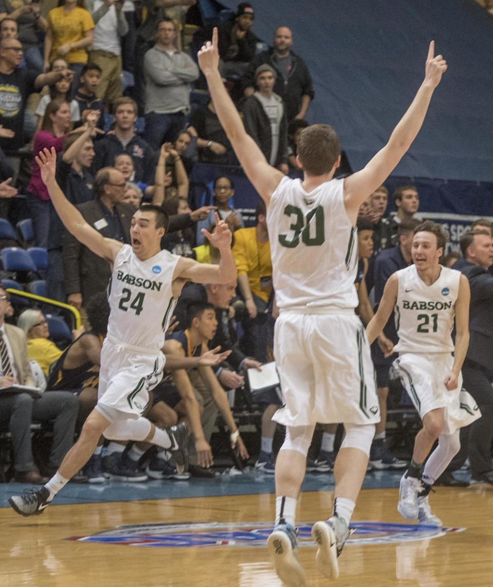 Babson's Charlie Rice (24), Nick Comenale (21) and Frank Oftring (30) celebrate the team's win.