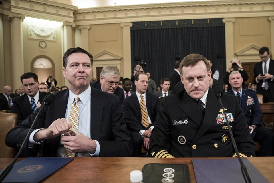 FBI Director James Comey and Michael Rogers, director of the National Security Agency, testify before the House Intelligence Commitee Monday.
