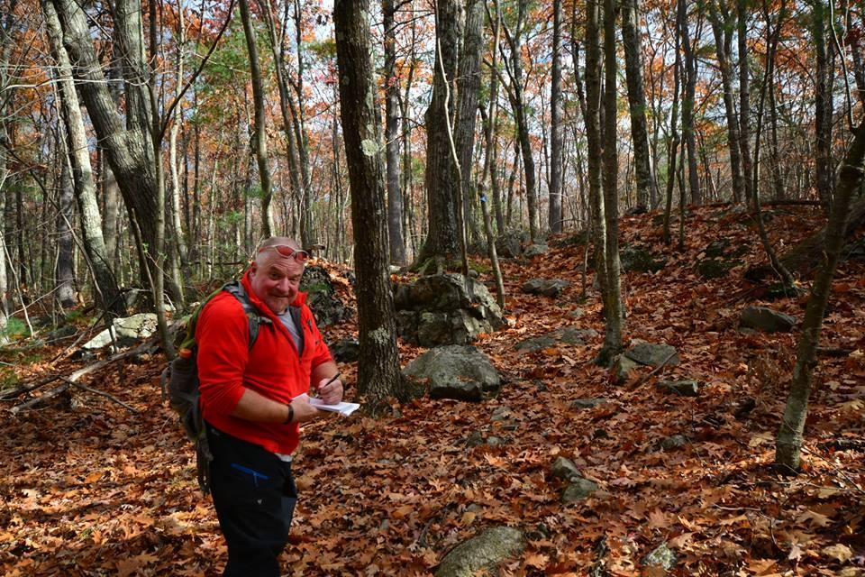 26zorec - Guidebook author Lafe Low of Franklin taking notes while hiking through the forests of Cedar Hill in Northborough. (Peter Tamposi)