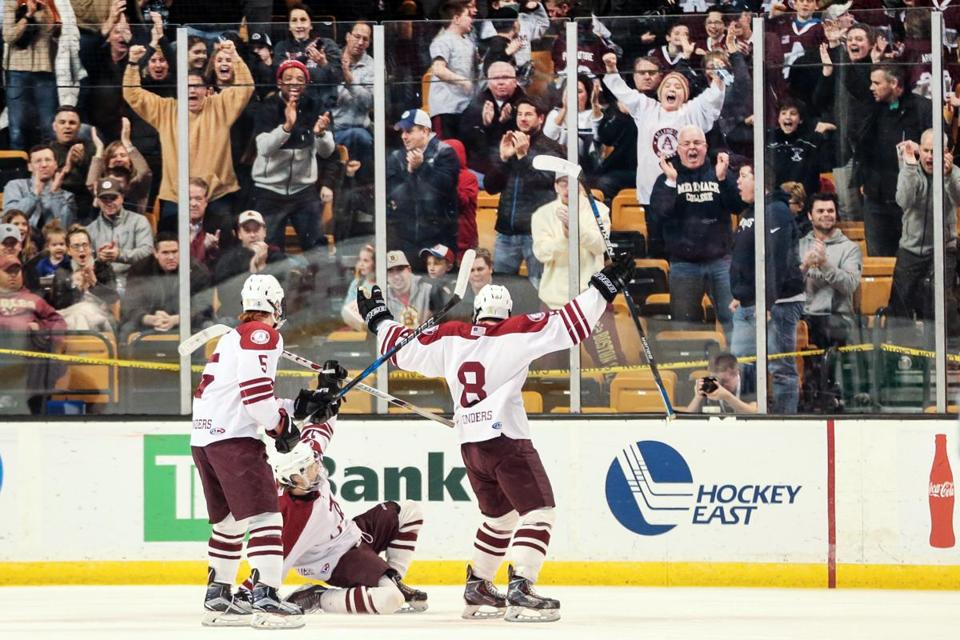 03/19/2017 BOSTON, MA Arlington celebrated their first goal during the Division 1A finals between the Arlington Spy Ponders and the Central Catholic Raiders (cq) at the MIAA High School Hockey Tournament held at TD Garden in Boston. (Aram Boghosian for The Boston Globe)
