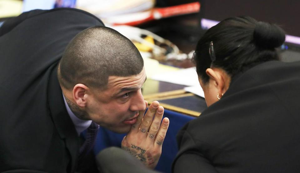 Boston, MA--3/21/2017 - Former New England Patriots tight end Aaron Hernandez (cq) speaks to defense attorney Michelle Medina (cq) during a sidebar. His double murder trial continues in Suffolk Superior Court. He is accused of killing Daniel de Abreu (cq) and Safiro Furtado (cq) in Boston's South End, on July 16, 2012. POOL Photo by Topic: 22hernandez Reporter: XXX
