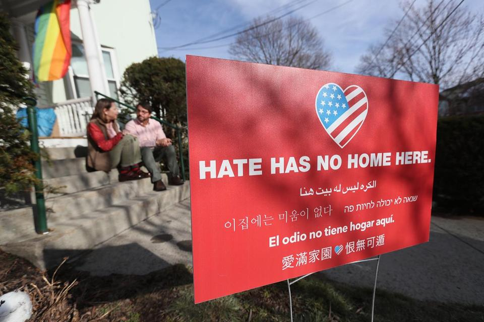 Jason and Elizabeth DelPorto with their anti-hate sign in their Watertown front yard.