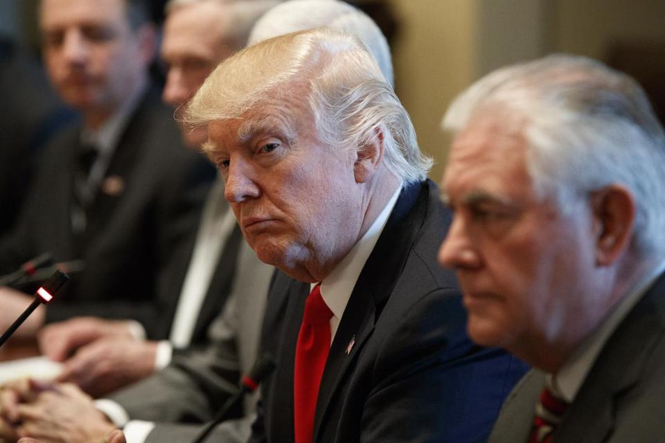 FILE - In this March 20, 2017 file photo, President Donald Trump listens as Iraqi Prime Minister Haider al-Abadi speaks during a meeting in the Cabinet Room of the White House in Washington. Secretary of State Rex Tillerson is at right. North Korea has a criticism of U.S. President Donald Trump he probably wasn't expecting: he's too much like Barack Obama. In its first comments since Tillerson's swing through Asia, the North is making much of the former oil executive's surprisingly blunt assessment that Obama's strategy needs to be replaced and U.S. efforts to get North Korea to denuclearize over the past 20 years have been a failure. But, it says, Trump is adopting the same stance nevertheless. (AP Photo/Evan Vucci, File)