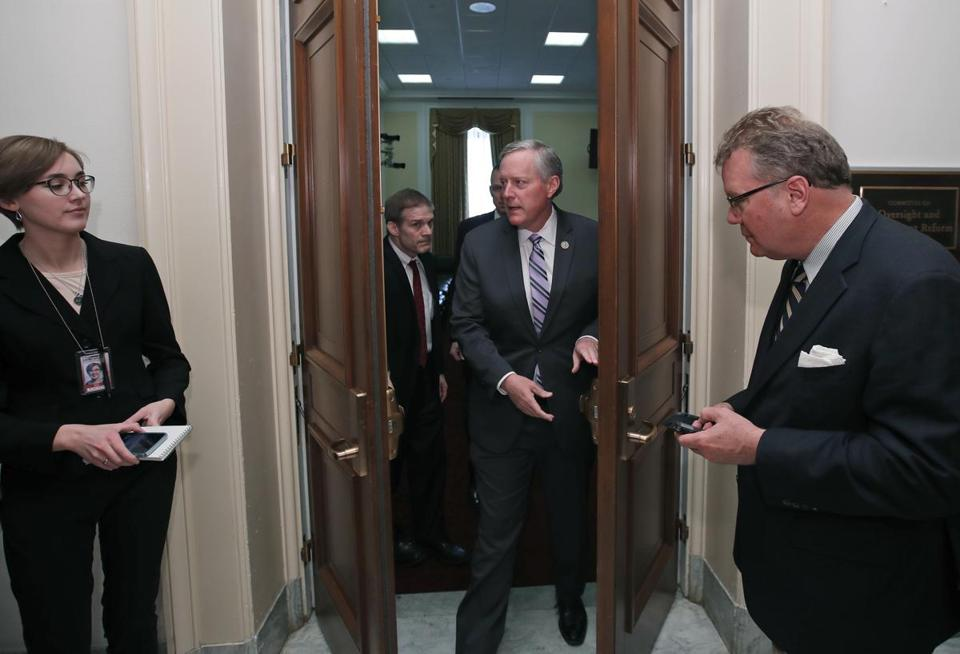 "House Freedom Caucus Chairman Rep. Mark Meadows, R-N.C. departs a Freedom Caucus meeting on Capitol Hill in Washington, Thursday, March 23, 2017. GOP House leaders delayed their planned vote on a long-promised bill to repeal and replace ""Obamacare,"" in a stinging setback for House Speaker Paul Ryan and President Donald Trump in their first major legislative test. (AP Photo/Alex Brandon)"