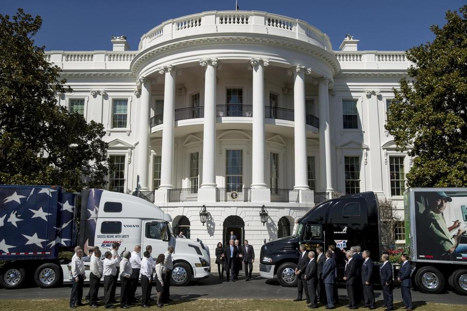 President Donald Trump walks out of the White House in Washington, Thursday, March 23, 2017, to meet with truckers and industry CEOs regarding healthcare, on the South Lawnn. (AP Photo/Andrew Harnik)