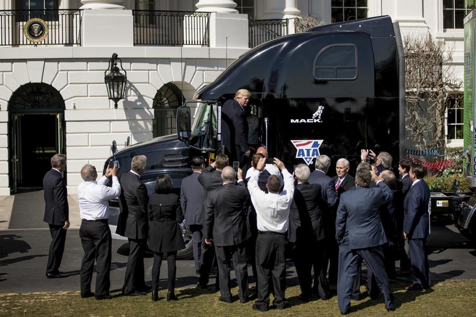 President Donald Trump gets out of an 18-wheeler as he meets with truckers and industry CEOs regarding healthcare, Thursday, March 23, 2017, on the South Lawn of the White House in Washington. (AP Photo/Andrew Harnik)