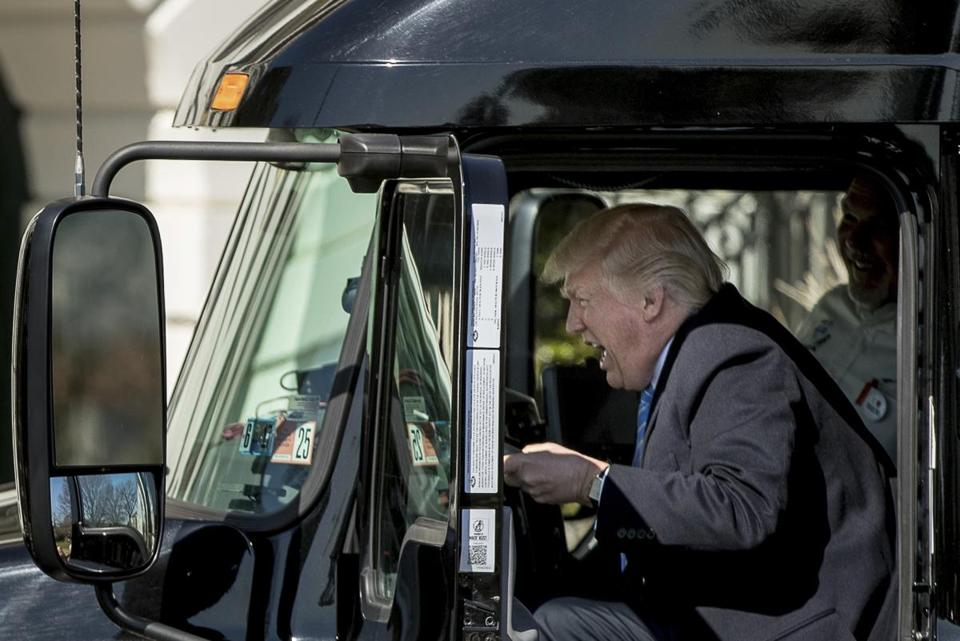 President Donald Trump pretends to drive an 18-wheeler as he meets with truckers and industry CEOs regarding healthcare, Thursday, March 23, 2017, on the South Lawn of the White House in Washington. (AP Photo/Andrew Harnik)
