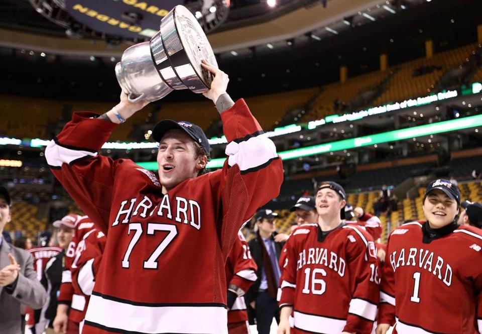 BOSTON, MA - FEBRUARY 13: Lewis Zerter-Gossage #77 of the Harvard Crimson celebrates after defeating the Boston University Terriers 6-3 in the 2017 Beanpot Tournament Championship at TD Garden on February 13, 2017 in Boston, Massachusetts. (Photo by Maddie Meyer/Getty Images)