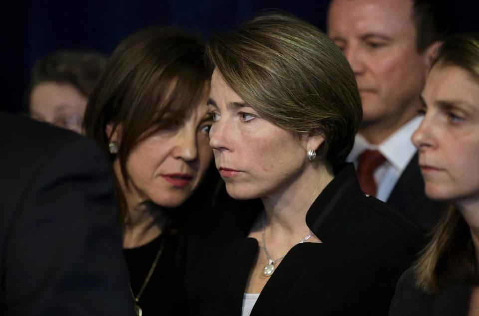Massachusetts Attorney General Maura Healey, center, listens to Eva Millona, executive director of the Mass. Immigrant and Refugee Advocacy Coalition, left, during a news conference Tuesday, Jan. 31, 2017, in Boston. Healey is joining a lawsuit filed by the American Civil Liberties Union of Massachusetts challenging President Donald Trump's executive order on immigration. (AP Photo/Steven Senne)