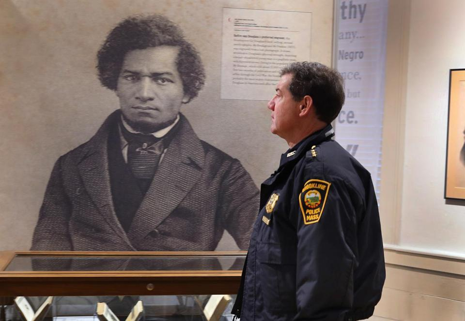 Deputy Superintendent Michael Gropman looked at a photo of Frederick Douglass at the Museum of African American History.