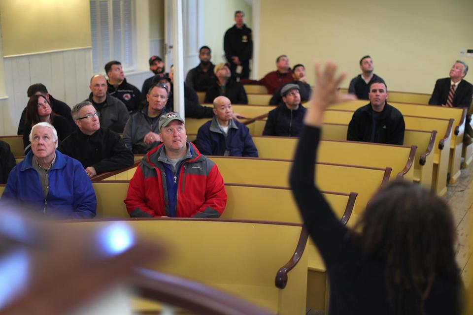 Frazier talked with Brookline police officers inside the historic African Meeting House.