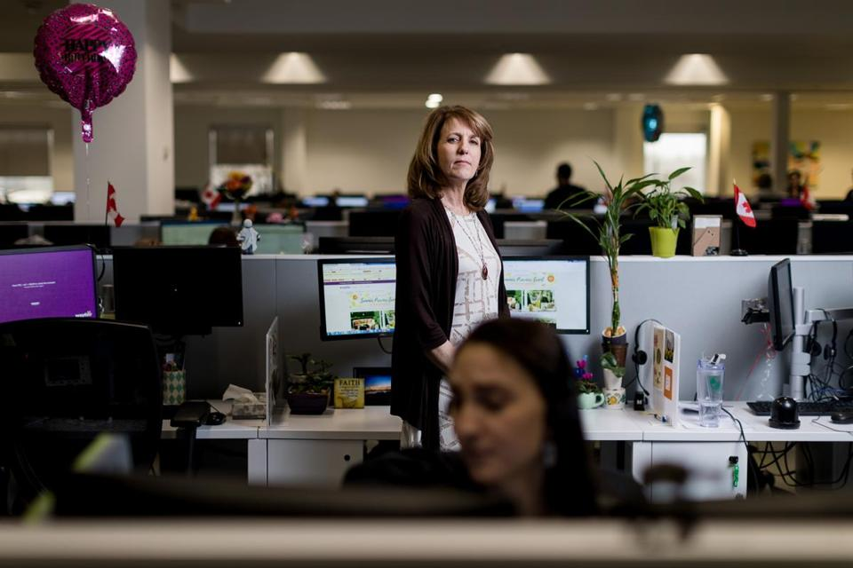 Bangor, ME, United States -- Colette McCauley (cq), a sales and service consultant, stands at her desk at a Wayfair call center in Bangor, ME on Friday, March 24, 2017. Maine has seen an increase in call centers throughout the state. (Yoon S. Byun for the Boston Globe) Slug: 28callcenters Reporter: LOID: 8.3.1986096335