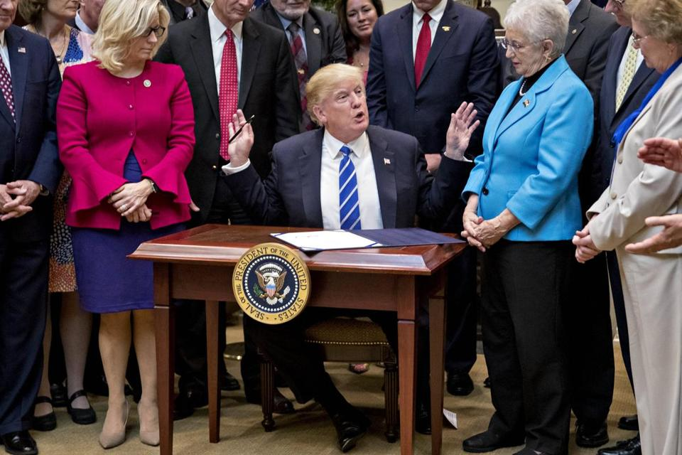 Trump Was Made To Sign Bills On A Very Small Desk