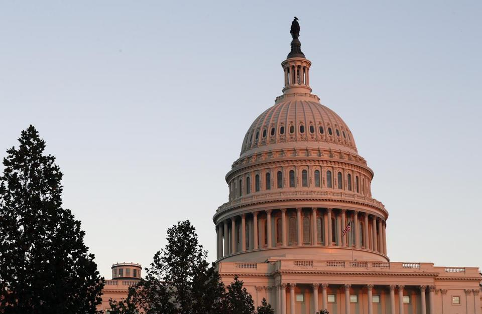 The US Capitol dome as seen at sunset in November.