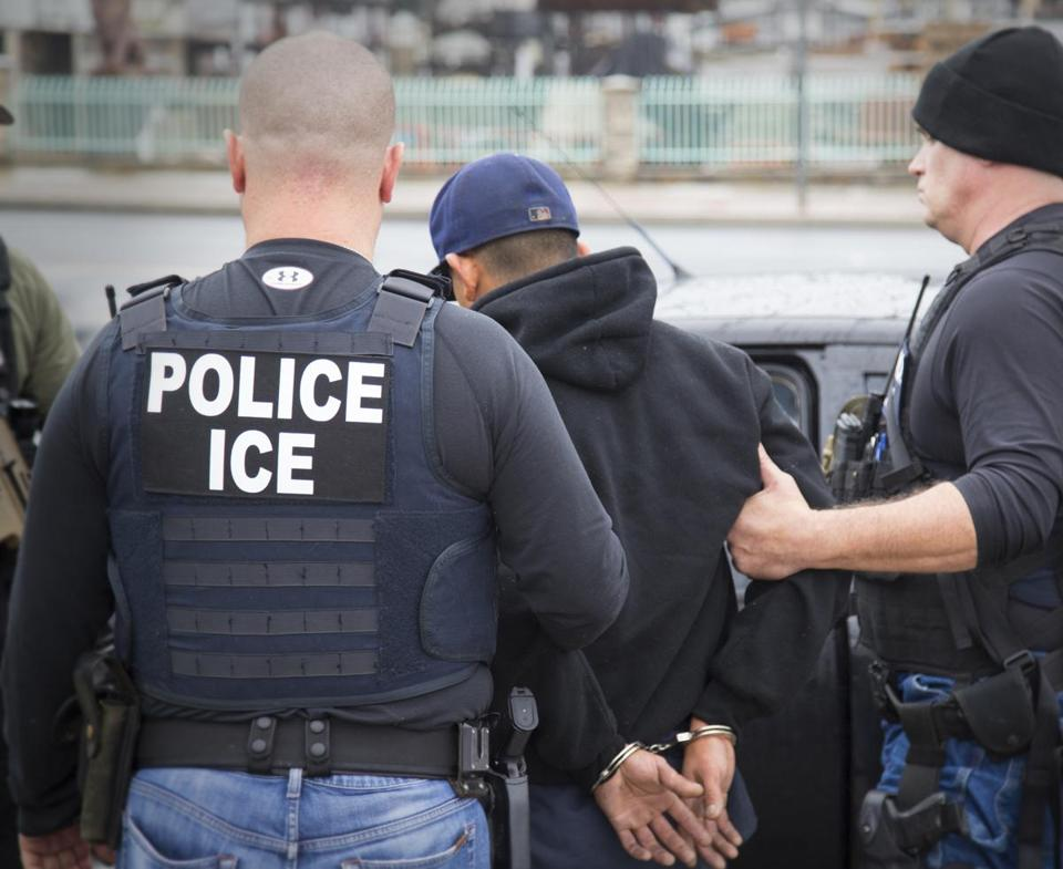 In this photo from February and released by US Immigration and Customs Enforcement showed people being arrested during a targeted enforcement operation in California.