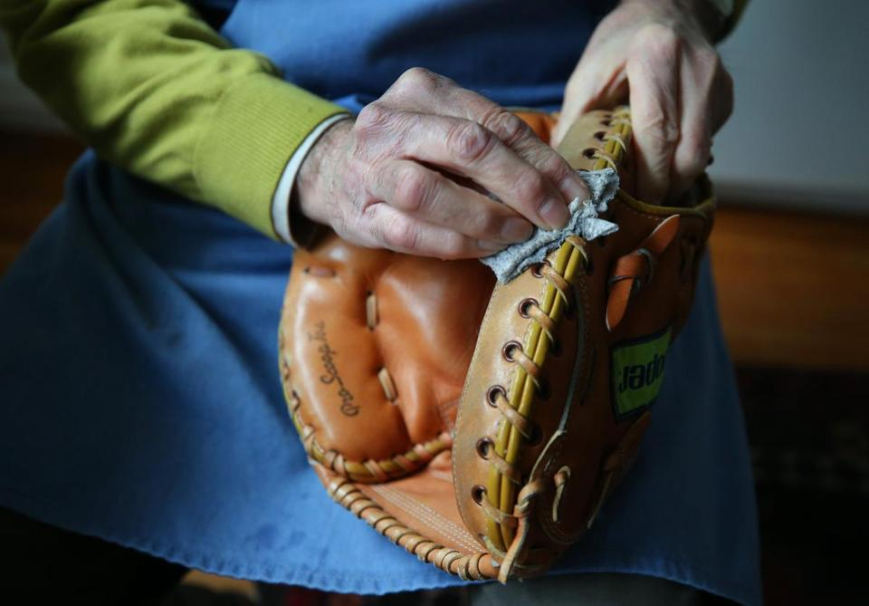 Baseball glove repair man Robert Megerdichian worked on a glove in his Cambridge home. He often does his work with a ballgame on in the background.