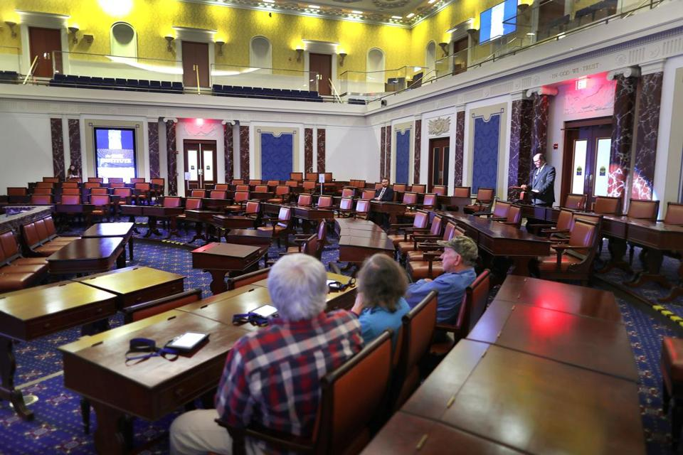 Boston-03/29/2017- The numbers of visitors are below expectations at the Edward Kennedy Institute. Three people were the only visitors inside a replica of the Senate Chamber as they hear a presentation. John Tlumacki/Globe staff(metro)