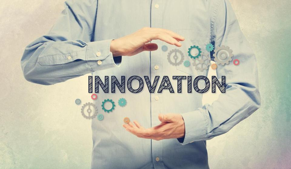 Young man in blue shirt holding Innovation concept