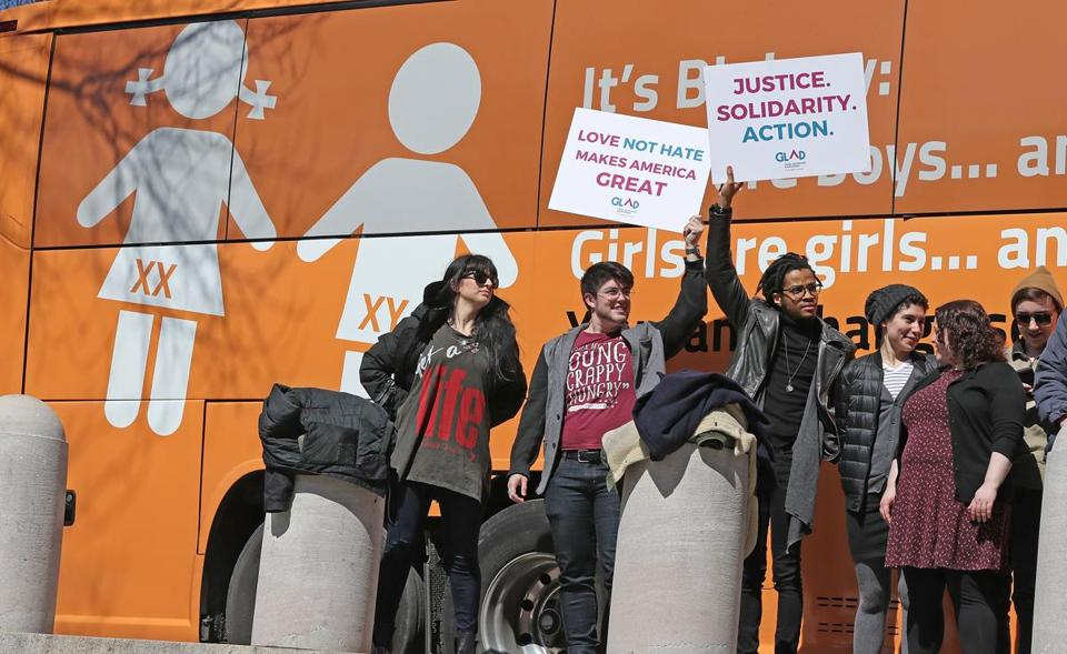 BOSTON, MA - 3/30/2017: Bus displaying anti-transgender messages, the so-called Free Speech Bus is travelling through Boston with stops at City Hall and seeen here by the State House with protesters greeting it. (David L Ryan/Globe Staff Photo) SECTION: METRO TOPIC 31bus