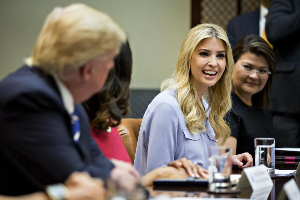 epa05874013 Ivanka Trump, daughter of U.S. President Donald Trump, speaks as US President Trump, left, listens during a meeting with women small business owners in the Roosevelt Room of the White House in Washington, DC, USA, 27 March 2017. Investors further unwound trades initiated in November resting on the idea that the election of Trump and a Republican Congress meant smooth passage of an agenda that featured business-friendly tax cuts and regulatory changes. EPA/ANDREW HARRER / POOL