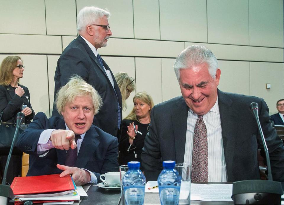 epa05880912 US Secretary of State Rex Tillerson (R), Polish Minister of Foreign Affairs Witold Waszczykowski (C) and British Foreign Secretary Boris Johnson (L) attend NATO foreign ministers meeting at alliance headquarters, in Brussels, Belgium, 31 March 2017. NATO Foreign Ministers gathered for a one day meeting of the North Atlantic Council (NAC). EPA/STEPHANIE LECOCQ