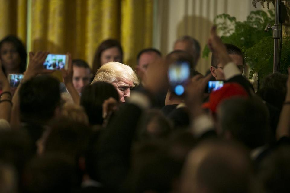 "FILE -- President Donald Trump greets attendees of a Greek Independence celebration in the East Room of the White House in Washington, March 24, 2017. ""Change libel Laws?"" President Trump asked in a recent tweet, returning to a favorite theme on the campaign trail. In reality he has no power to to do so, and there is virtually no strategy he could pursue that would have much, if any, chance of changing libel laws. (Al Drago/The New York Times)"
