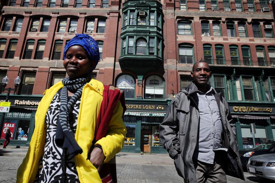 Vanisi Uzamukunda, left, and her husband Sendegeya Bayavuge crossed Merrimack Street on their way to an appointment with their caseworker at the International Institute of New England in Lowell.
