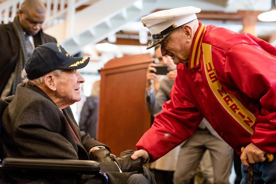 "Thomas Hudner greeted John ""Red"" Parkinson, who was a Marine in the Korean War and fought in the Chosin Reservoir, at a reception after the christening of the USS Hudner."