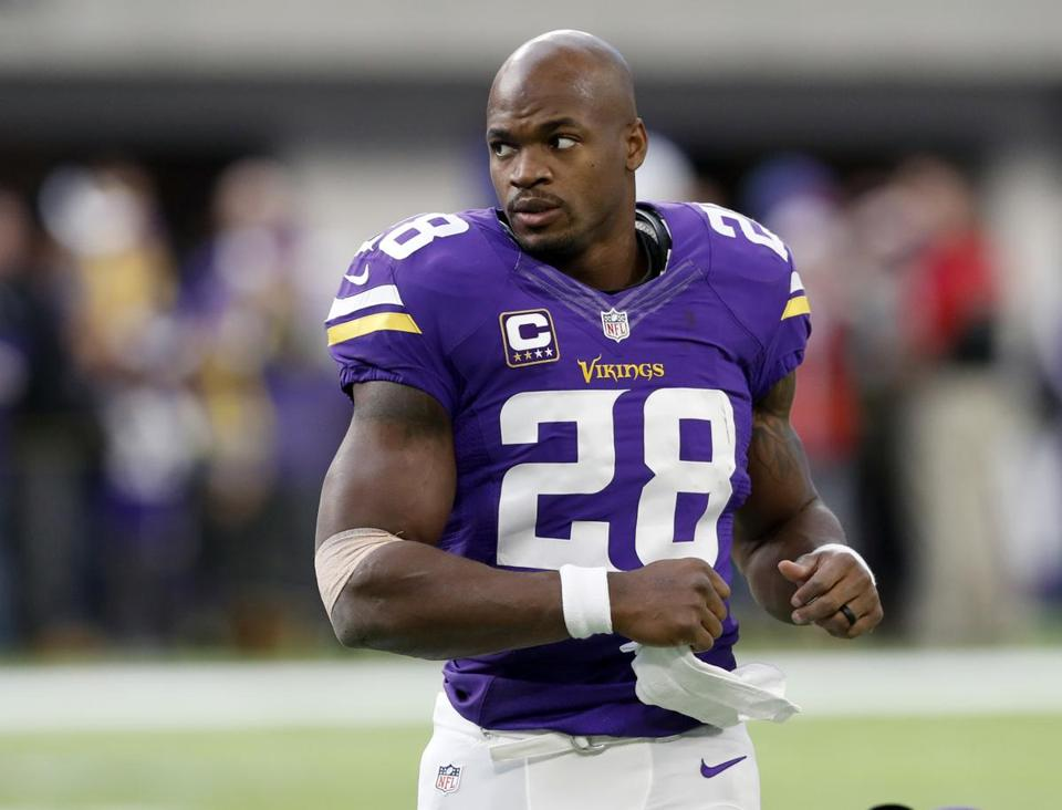 Minnesota Vikings running back Adrian Peterson warms up before the start of an NFL football game between the Indianapolis Colts and the Minnesota Vikings Sunday, Dec. 18, 2016, in Minneapolis. (AP Photo/Charlie Neibergall)