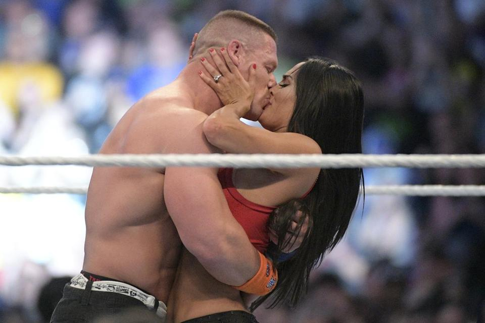 John Cena and Nikki Bella kissed after they got engaged at WrestleMania 33 in 2017.