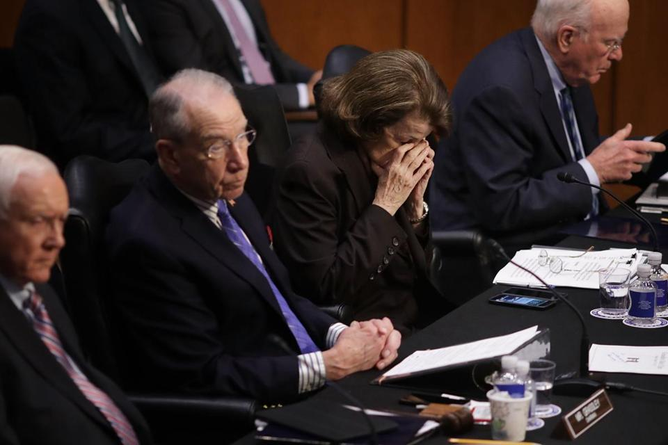 Senator Dianne Feinstein, a California Democrat, close her eyes as the judiciary committee voted on Supreme Court nominee Neil Gorsuch.