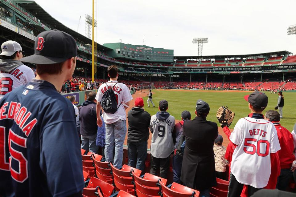 Boston-04/03/2017- Opening Day at Fenway Park- Red Sox played the Pirates- Fans in right field wait for long fly ball during batting practice. John Tlumacki/Globe staff(sports)