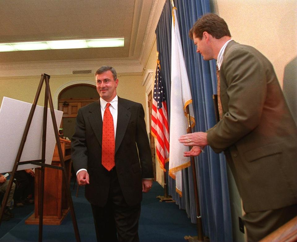 Charlie Baker (right) applauded as then-Governor Paul Cellucci left the podium following a 1997 news conference at the State House.