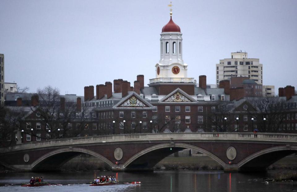 Rowers paddled down the Charles River near the campus of Harvard University in Cambridge, Mass.