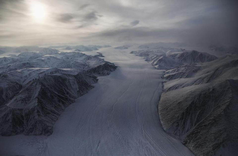 ELLESMERE ISLAND, CANADA - MARCH 29: A section of a glacier is seen from NASA's Operation IceBridge research aircraft on March 29, 2017 above Ellesmere Island, Canada. The ice fields of Ellesmere Island are retreating due to warming temperatures. NASA's Operation IceBridge has been studying how polar ice has evolved over the past nine years and is currently flying a set of eight-hour research flights over ice sheets and the Arctic Ocean to monitor Arctic ice loss aboard a retrofitted 1966 Lockheed P-3 aircraft. According to NASA scientists and the National Snow and Ice Data Center (NSIDC), sea ice in the Arctic appears to have reached its lowest maximum wintertime extent ever recorded on March 7.Scientists have said the Arctic has been one of the regions hardest hit by climate change. (Photo by Mario Tama/Getty Images)