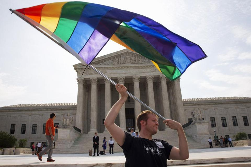 A man waved a rainbow flag in support of gay marriage outside of the Supreme Court in Washington in 2015.