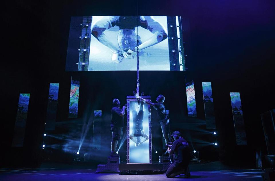 "Andrew Basso, a.k.a. ""The Escapologist,'' during an attempt to free himself from a water tank during a performance of ""The Illusionists: Live from Broadway."""