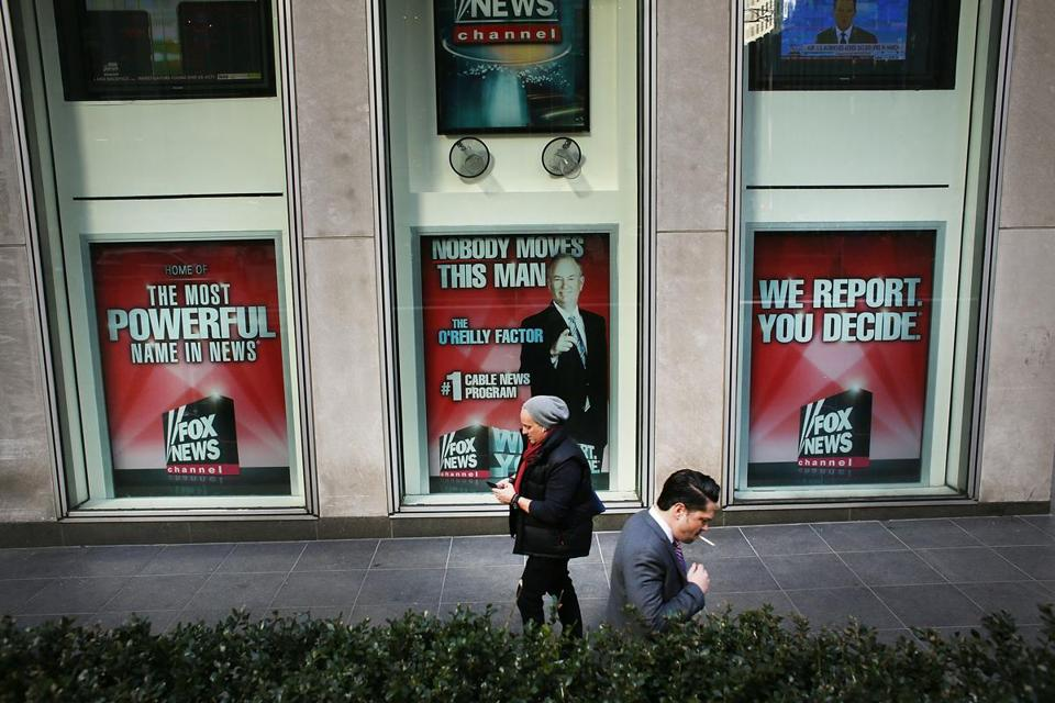 "NEW YORK, NY - APRIL 05: An advertisement for Bill O'Reilly's top-rated Fox News show is displayed in the window of the News Corporation headquarters on April 5, 2017 in New York City. Following allegations that he sexually harassed several women, over a dozen major advertisers, have pulled their ads from ""The O'Reilly Factor."" (Photo by )"