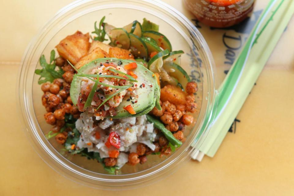 April 6, 2017_ SOMERVILLE -- Manoa Poke for Cheap Eats. -- The Kelaguen bowl with Lomi Lomi (salt cured salmon belly) and advocado. (Joanne Rathe/ Globe Staff section: food lifetyle topic:12cheap )
