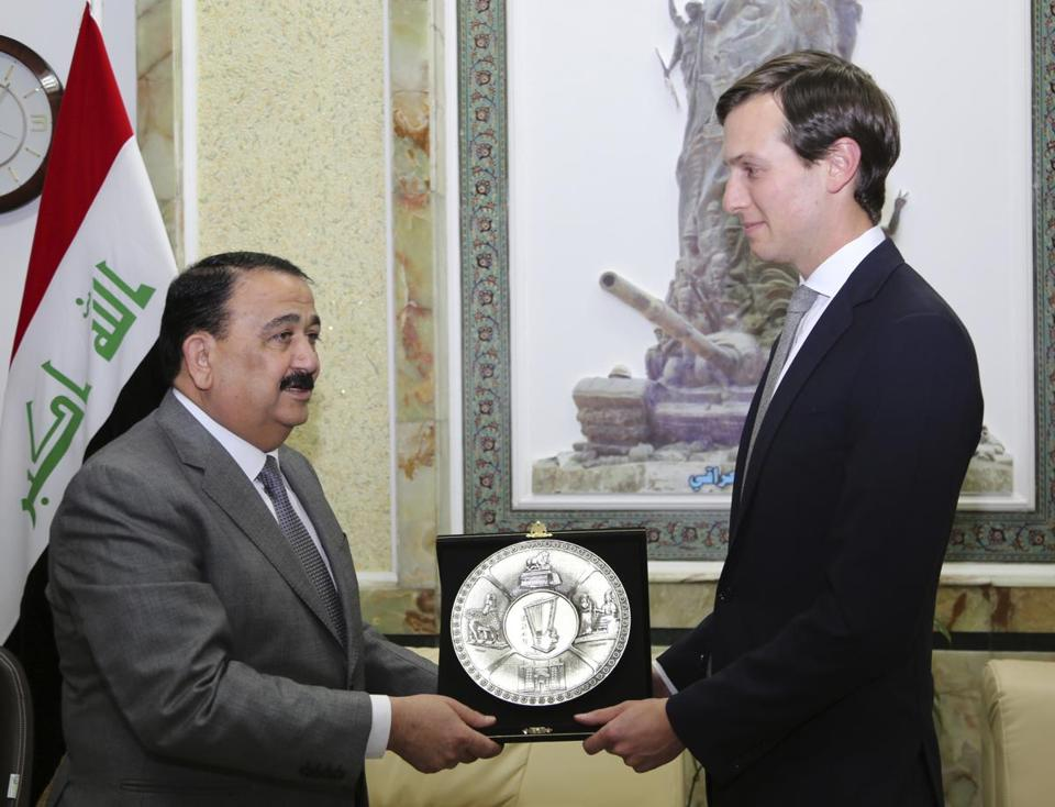 Visiting Jared Kushner, right, US President Donald Trump's son-in-law and senior adviser, receives a gift from Iraqi Defense Minister, Ifran al-Hayali, at the Ministry of Defense, Baghdad, Iraq, Monday, April 3, 2017. (AP Photo)