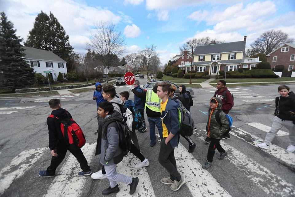 Belmont, MA., 04/07/17, School kids cross the intersection of Common and Washington Streets. Magazine feature on Belmont. Globe staff/Suzanne Kreiter