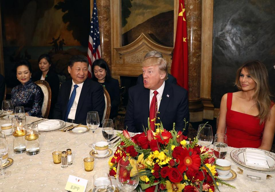 President Donald Trump and Chinese President Xi Jinping, with their wives, first lady Melania Trump and Chinese first lady Peng Liyuan, during dinner at Mar-a-Lago.