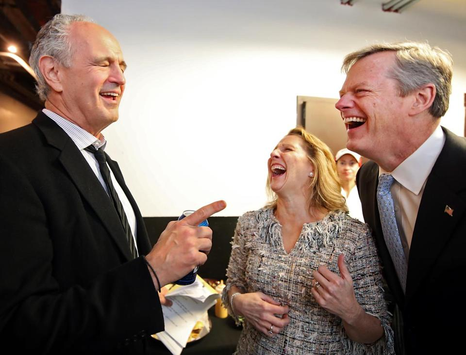 Boston MA 4/7/17 Jim Braude (cq) sayng something funny to Massachusetts Governor Charlie Baker and his wife, Lauren Baker (cq) backstage at The 25th Annual Banned in Boston a benefit for Urban Improv at the House of Blues. (Photo by Matthew J. Lee/Globe staff) topic: 08syriareaxpic reporter: