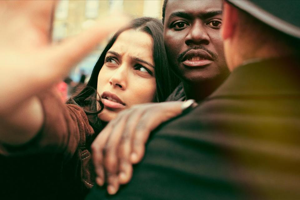 "Freida Pinto (left) and Babou Ceesay star in ""Guerrilla"""