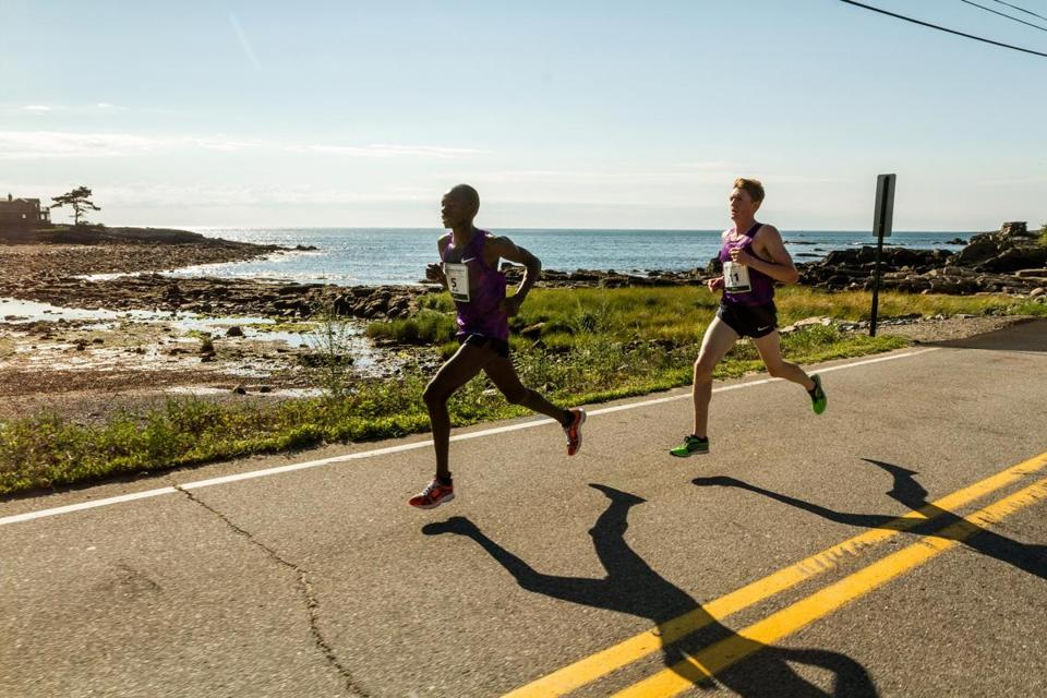 Runners pass Pond Cove during the TD Beach to Beacon 10K in Maine.