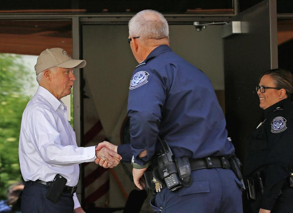 Attorney General Jeff Sessions, left, shakes hands with U.S. Customs and Border Protection officers as he tours the U.S.-Mexico border, Tuesday, April 11, 2017, in Nogales, Ariz. Sessions announced making immigration enforcement a key Justice Department priority, saying he will speed up deportations of immigrants in the country illegally who were convicted of federal crimes. (AP Photo/Ross D. Franklin)