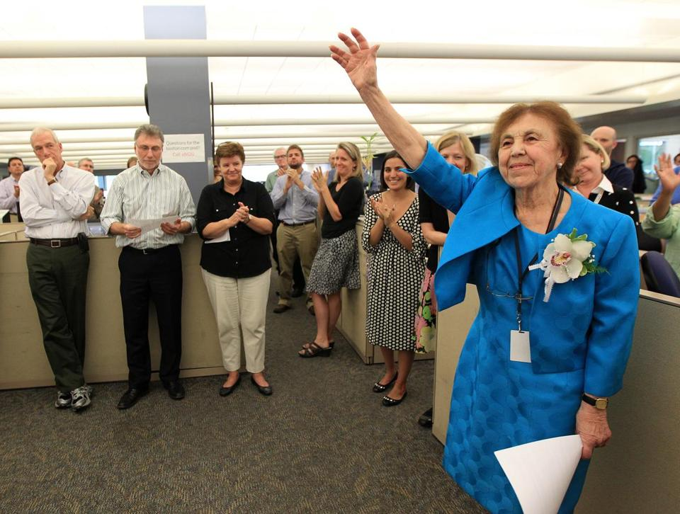 Boston, MA - 09/13/12 - Long time Boston Globe reporter Gloria Negri bids a fond farewell to her fellow colleagues at her retirement sendoff in the Globe editorial newsroom. - (Globe Staff Photo / Barry Chin) section: Metro, reporter: unknown, slug: 14negri, LOID: 5.0.274994604.
