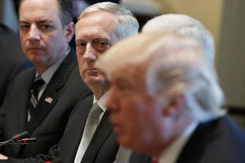 White House Chief of Staff Reince Priebus, left, and Defense Defense James Mattis listen as President Donald Trump speaks during a meeting with Iraqi Prime Minister Haider al-Abadi in the Cabinet Room of the White House in Washington, Monday, March 20, 2017. (AP Photo/Evan Vucci)