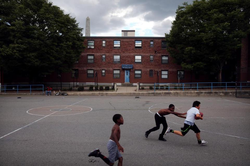 Boys played football at the Bunker Hill Housing Development in 2015.